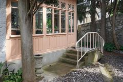 Entrance to the house from the garden through a wooden veranda. Royalty Free Stock Images