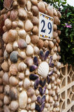 Entrance to the house made from seashells Stock Photo