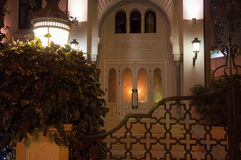 Entrance to the house at night with lanterns and a fence in an oriental style Stock Photography