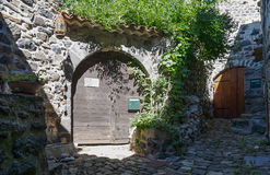 Entrance to the house on a stone street in the picturesque village of Mirabel Ardèche, France.. Royalty Free Stock Photos