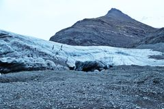 Entrance to Icelandic ice cave. The entrance to Icelandic ice cave in the massive glacier Stock Photo