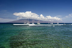Entrance to Lahaina Harbor with boats and the island of Lanai, Maui, Hawaii Stock Images
