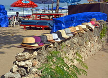 Entrance to Legian Beach including Sun Umbrellas and Hats. Royalty Free Stock Photos