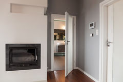 Entrance to lounge. White entrance door to lounge and fireplace Royalty Free Stock Photos