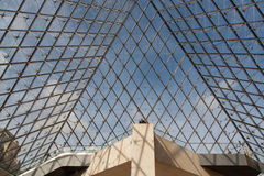 Entrance to the Louvre and man. The photo shows the entrance to the Louvre and man on the top Royalty Free Stock Photo