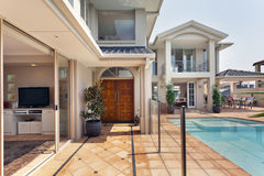Entrance to luxurious australian mansion. Entry way to luxurious australian mansion with pool royalty free stock images