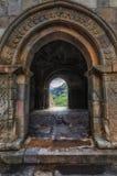Entrance to main touristic area in Vardzia ancient cave city, Georgia. Ruins of Tamara palace. Royalty Free Stock Image