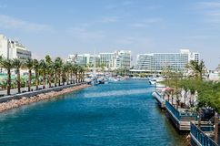 Entrance to marina, with promenades, modern hotel complexes, palms, Eilat, Israel. EILAT, ISRAEL – November 7, 2017:  entrance to marina, with promenades Royalty Free Stock Image