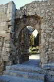 The entrance to the medieval walls in the city park on the island of Rhodes in Greece Stock Photo