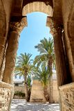 The entrance to the Medina antique columns. Views of palm trees in the courtyard of the castle Royalty Free Stock Image