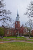 Entrance to Memorial Church and tourists in Harvard Yard. In the campus of Harvard University in Cambridge, Massachusetts, MA, USA. It is built in honor of Royalty Free Stock Photography