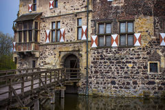 Entrance to moated castle. Vichering (13th century), located in Germany royalty free stock photos