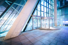 Entrance to a modern building at night, in Vienna, Austria. Royalty Free Stock Photography