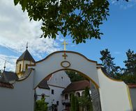 Entrance to a monastery and church tower in background. Entrance to a monastery, and church tower in background Royalty Free Stock Photos