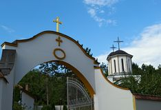 Entrance to a monastery and church tower in background. Entrance to a monastery, and church tower in background Stock Images