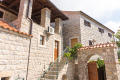 Entrance to the monastic cells in Monastery Rezevici in Montenegro stock photos