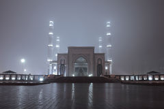 Entrance to the mosque in mysterious foggy night.  Royalty Free Stock Images