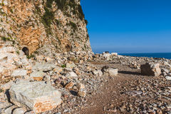 Entrance to Mountain Tunnel on Rocky Coast Stock Photography