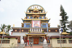 Entrance to Namdroling Monastery in South India. The main entrance gate to the famous Buddhist monastery dedicated to Nyingmapa lineage of Tibetan Buddhists stock images