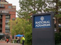 Entrance to the National Aquarium on the Baltimore Inner Harbor with Power Plant shopping plaza in background royalty free stock photos