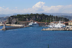 Entrance to Nice's harbour. There's view on entrance to the harbour of Nice from seaside in May 2015. Also there's view on hill Chateau from seaside Royalty Free Stock Images