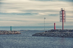 Entrance to the Northern Sea bay with lighthouses. Estonia. Saarema. Entrance to the Northern Sea bay from the lighthouse at the background of clouds and large Stock Photos