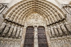 Entrance to Notre-Dame cathedral in Paris royalty free stock photography