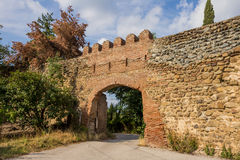 Entrance to old castle. In vricky wall stock photography