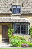 Entrance to old cottage with grape vine in English countryside Stock Images