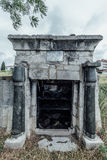 Entrance to an old family-owned mausoleum, a crypt on an abandoned Jewish cemetery Stock Photos