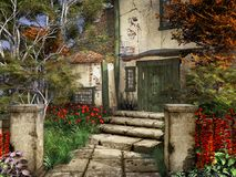 Entrance to old farmhouse. With trees and colorful flowers Royalty Free Stock Photo