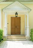 Entrance to the old mansion in the columns holding up the triangular visor over the porch Royalty Free Stock Photos