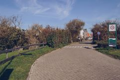 Entrance to Oudeschild town on Texel island. Paved entry road to Oudeschild town on Texel island royalty free stock photos