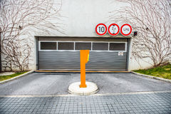 Entrance to the parking lot in residential house Royalty Free Stock Photos