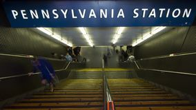 Entrance to Pennsylvania Station, NYC. People in motion at the Entrance of Pennsylvania Station in New York City stock video