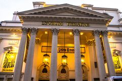 Entrance to the popular London's Lyceum theatre with Lion king displays. Stock Photo