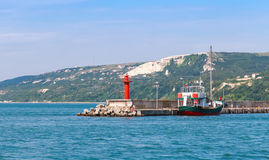 Entrance to port of Balchik, red lighthouse Royalty Free Stock Images