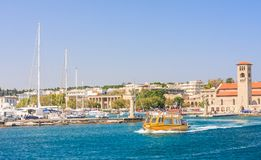 Entrance to the port of Mandraki Rhodes.  Greece Royalty Free Stock Photo