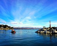 Entrance to the port Moscenicka Draga on the Adriatic sea in Croatia with town Rijeka in the background stock photos