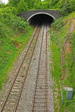 Entrance to Railway Tunnel. A railway line which is emerging from a tunnel Royalty Free Stock Image