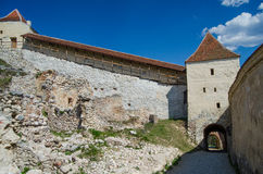 Entrance to Rasnov Fortress. An architectural detail from the entrance of Rasnov Fortress with battlements on a blue sky Stock Photo