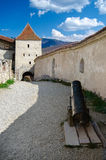 Entrance to Rasnov Fortress. An architectural detail from the entrance of Rasnov Fortress with battlements on a blue sky Royalty Free Stock Photo