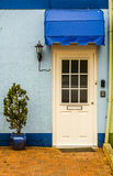 Entrance to a residential building, white door with windows, pla Royalty Free Stock Photos