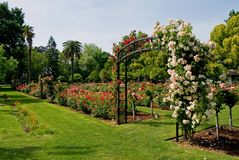 Entrance to rose garden Stock Photo