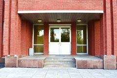 Entrance to the russian office building. Entrance to the red office building Royalty Free Stock Photo