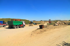 The entrance to the sand quarry. POLEWOJE, KALININGRAD REGION, RUSSIA — JUNE 18, 2014: The entrance to the sand quarry in the sunny day Royalty Free Stock Images