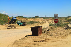 The entrance to the sand quarry. POLEWOJE, KALININGRAD REGION, RUSSIA — JUNE 18, 2014: The entrance to the sand quarry in the sunny day Stock Photos