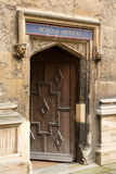 Entrance to School of Music at Bodeian Library. Carved wooden door at entrance to School of Music at Bodeian Library University of Oxford Royalty Free Stock Image