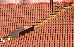 Entrance to the stadium with empty red seats. Exit to the stadium with empty red seats Royalty Free Stock Photo
