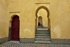 Entrance to a Tarfaya Mosque in Meknes, Morocco. Oriental mosaic tiles on steps to a mosque in Meknes, Morocco, North Africa Royalty Free Stock Photos